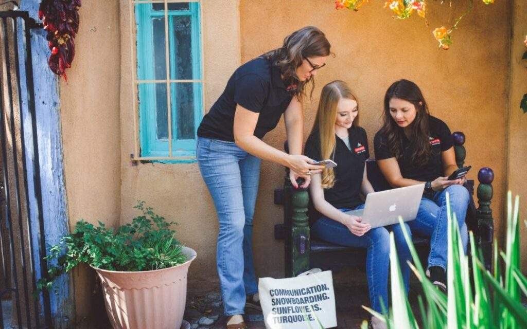Three LTDM employees work in Old Town, Albuquerque